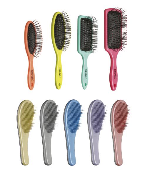 Cepillos de plástico para desenredar el cabello